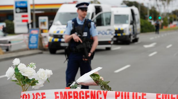 A police officer stands guard outside Linwood mosque in Christchurch, New Zealand, Monday, March 18, 2019. A live-streamed attack by an immigrant-hating white nationalist killed dozens of people Friday as they gathered for weekly prayers in Christchurch. (AP Photo/Vincent Thian)