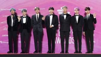Members of South Korean K-Pop group BTS pose for photos on the red carpet at the Seoul Music Awards at Gocheok Sky Dome in Seoul, South Korea, Tuesday, Jan. 15, 2019. (AP Photo/Lee Jin-man)