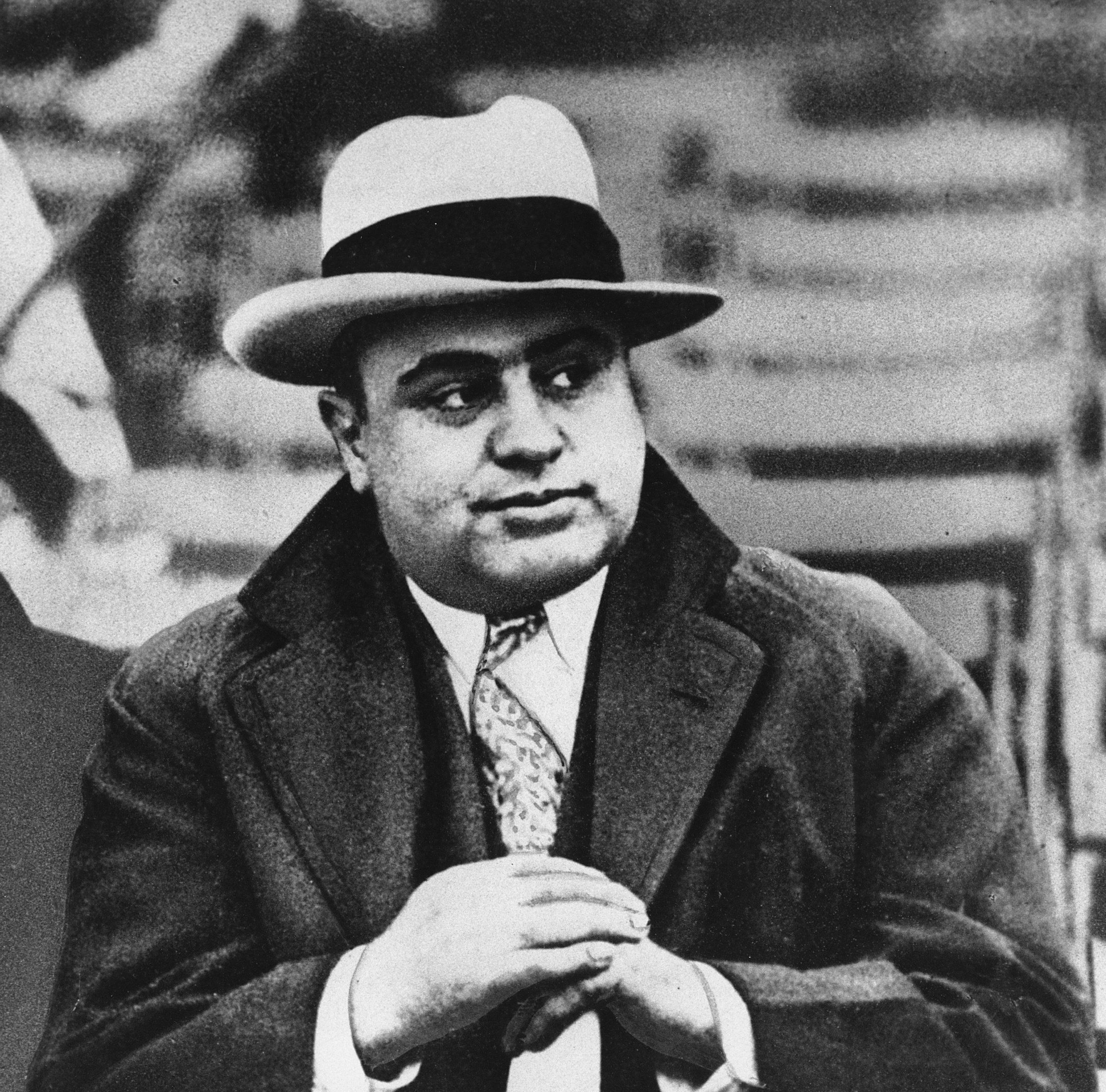 "FILE -  This Jan. 19, 1931, file photo shows Chicago mobster Al Capone at a football game. The way President Donald Trump sees it, Capone, the most famous gangster in American history, got off easy compared to Trump's former campaign chairman Paul Manafort. On Wednesday, Aug. 1, 2018, as Manafort stands trial for charges that include tax evasion, the same crime that landed Capone in Alcatraz, the president took to twitter to complain that Manafort is being treated far harsher than ""Public Enemy Number One."" ((AP File Photo)"