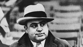 """FILE -  This Jan. 19, 1931, file photo shows Chicago mobster Al Capone at a football game. The way President Donald Trump sees it, Capone, the most famous gangster in American history, got off easy compared to Trump's former campaign chairman Paul Manafort. On Wednesday, Aug. 1, 2018, as Manafort stands trial for charges that include tax evasion, the same crime that landed Capone in Alcatraz, the president took to twitter to complain that Manafort is being treated far harsher than """"Public Enemy Number One."""" ((AP File Photo)"""