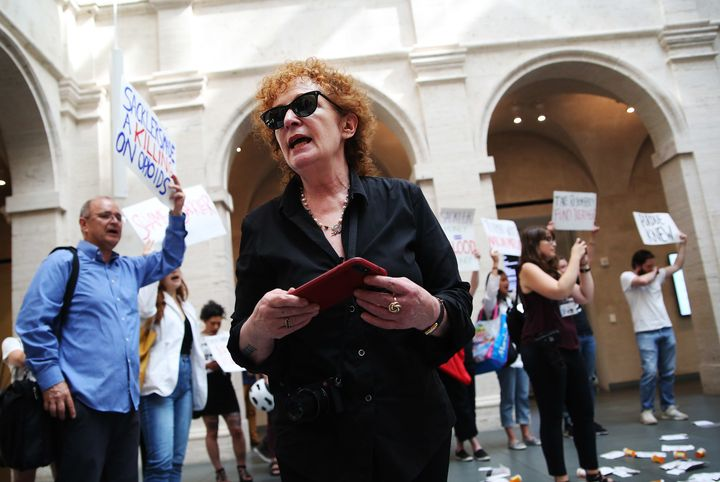 Photographer Nan Goldin leads a demonstration at the Harvard Art Museums in Cambridge, MA on July 20, 2018 to protest the ben