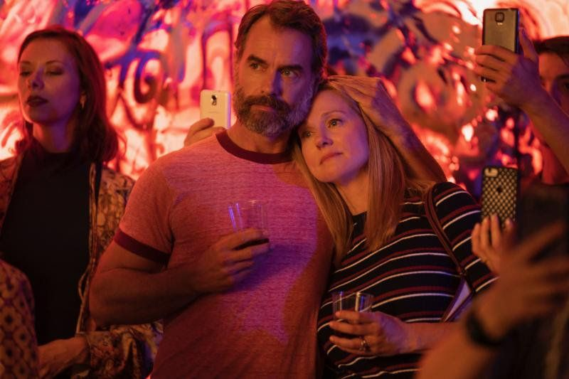 """Mary Ann Singleton (Laura Linney, right) canoodles with gay palMichael """"Mouse"""" Tolliver (Murray Bartlett).&"""