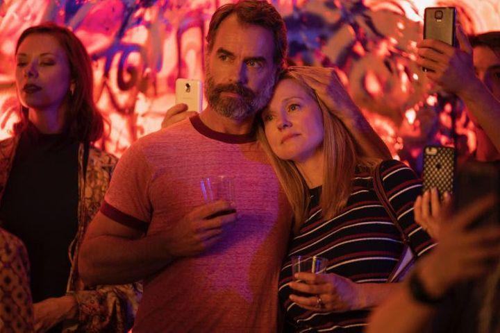 "Mary Ann Singleton (Laura Linney, right) canoodles with gay pal Michael ""Mouse"" Tolliver (Murray Bartlett).&"