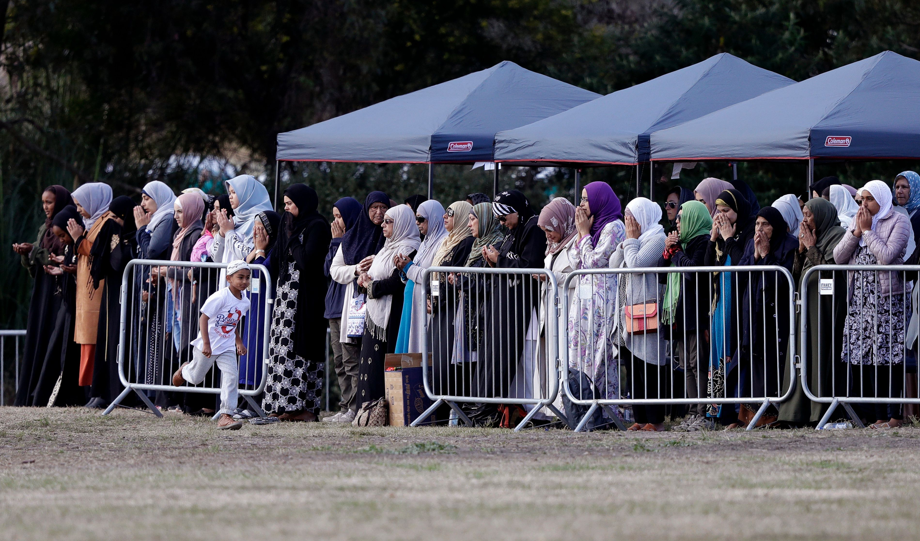 Women mourners pray during a funeral of a Friday March 15 mosque shooting victim at the Memorial Park