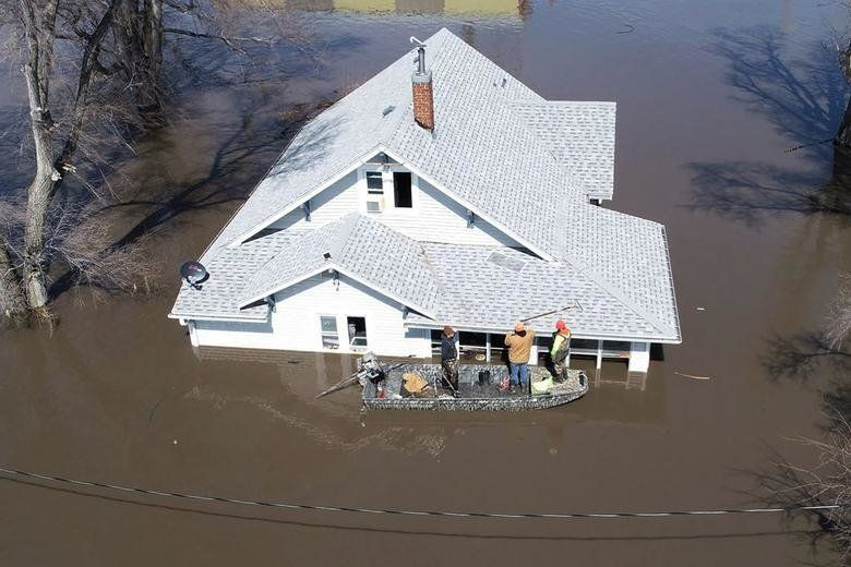 A late winter storm and spring melt have inundated Nebraska and Iowa, killing four people, tearing apart homes and businesses and cutting off small towns.