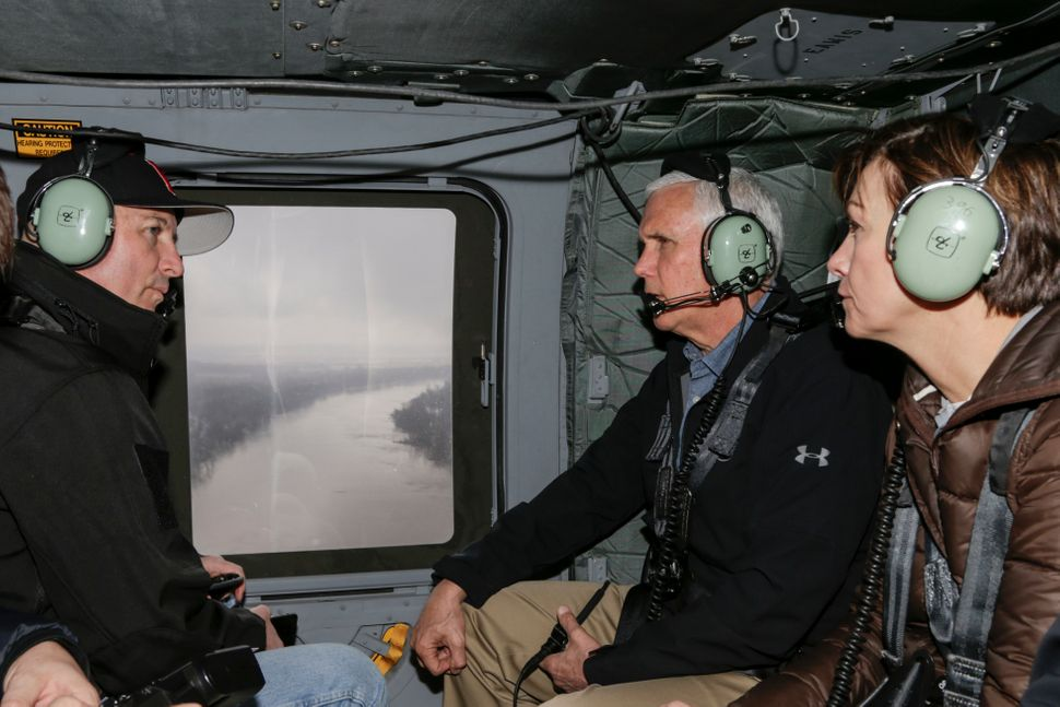 Vice President Mike Pence surveyed flooded areas in Nebraska on Tuesday and vowed to expedite action on presidential dis