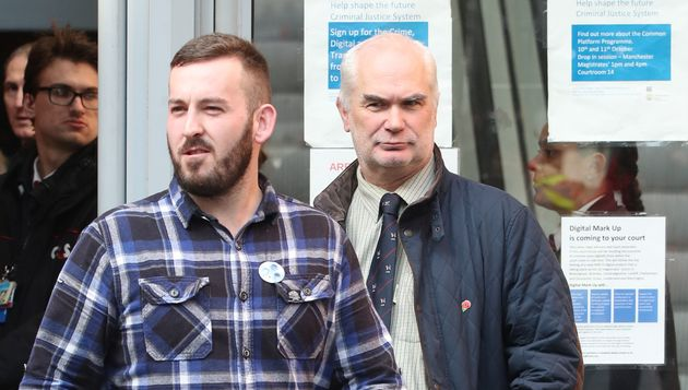 Protester James Goddard leaves Manchester Magistrates' Court, where he was charged with assault and a...