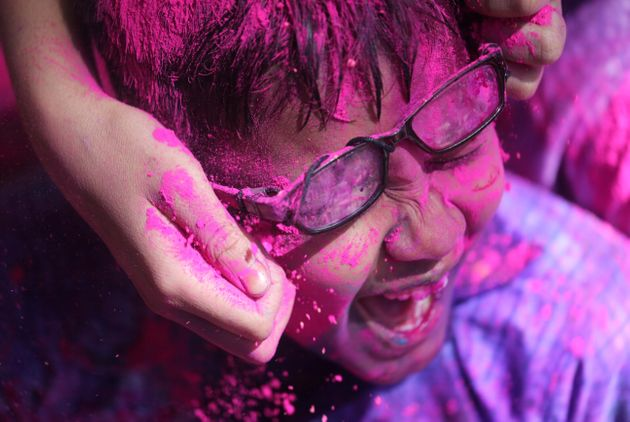 Children celebrate Holi in