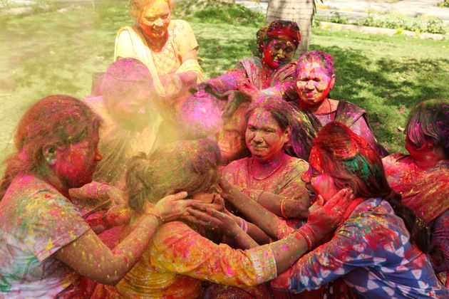 Women play holi in