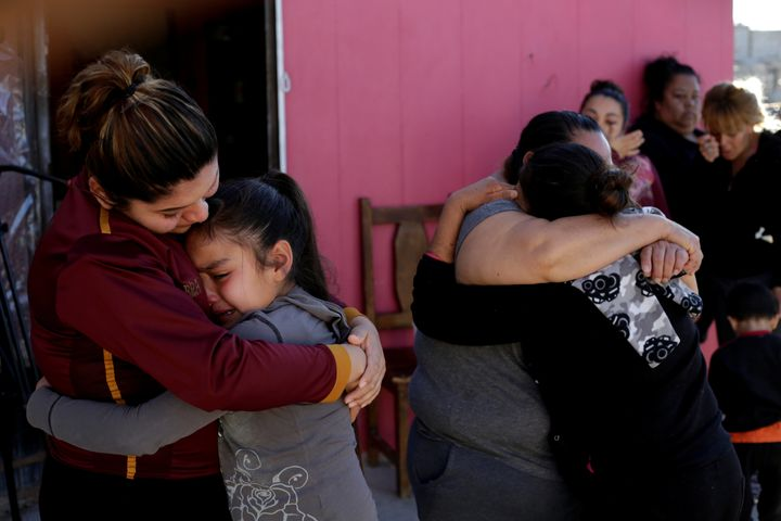 A woman in Ciudad Juarez, Mexico, embraces the daughter of Perez, a Mexican migrant who died at a Texas hospital on Monday.