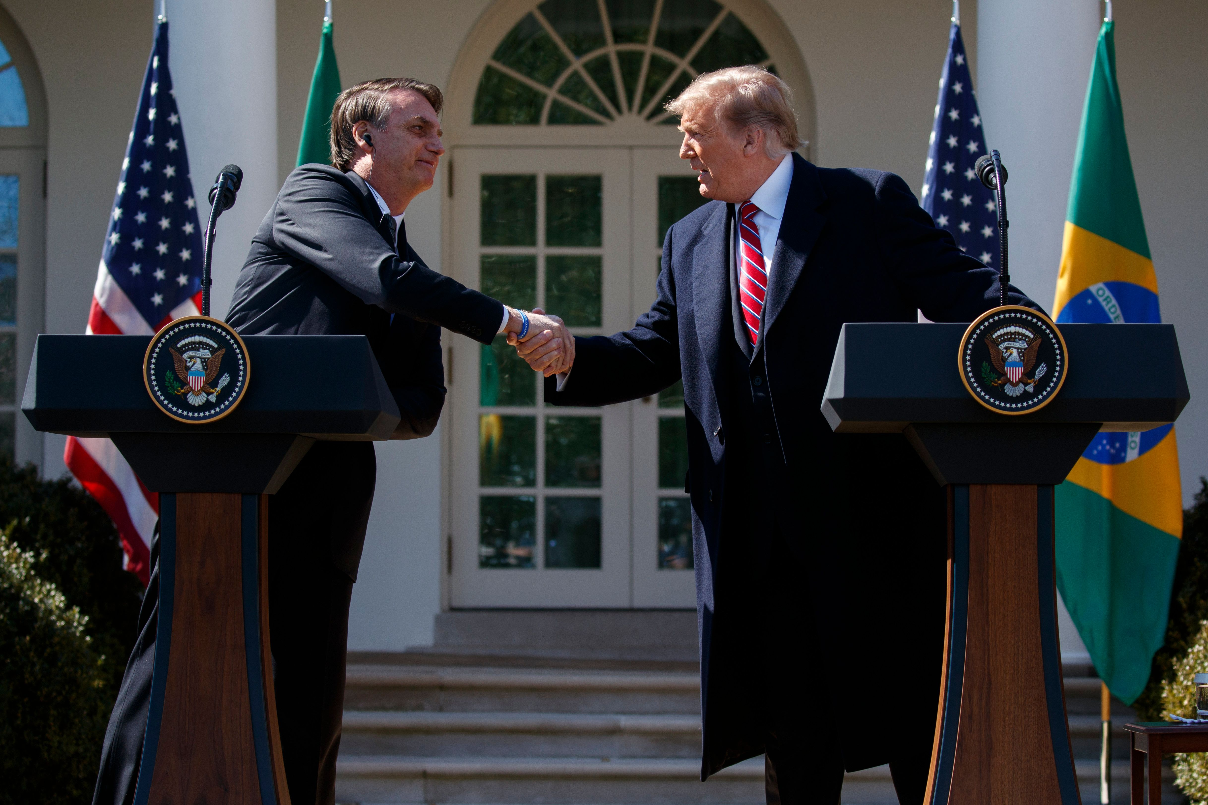 President Donald Trump and Brazilian President Jair Bolsonaro shake hands during a news conference in the Rose Garden of the White House, Tuesday, March 19, 2019, in Washington. (AP Photo/Evan Vucci)