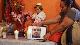 Sandra Perez places a photo of her late brother Rene Pablo Perez, a Mexican migrant who died at a hospital in El Paso, Texas, after being held by U.S. Customs and Border Protection (CBP), at an altar in her home in Ciudad Juarez, Mexico March 19, 2019. REUTERS/Jose Luis Gonzalez