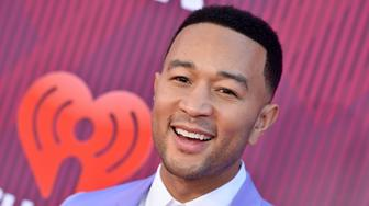 LOS ANGELES, CALIFORNIA - MARCH 14: John Legend arrives at the 2019 iHeartRadio Music Awards which broadcasted live on FOX at Microsoft Theater on March 14, 2019 in Los Angeles, California. (Photo by Axelle/Bauer-Griffin/FilmMagic)