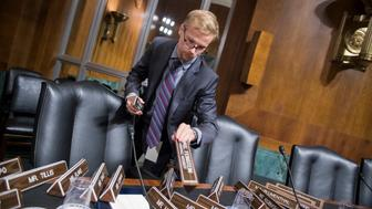 UNITED STATES - SEPTEMBER 26: Nathan Young arranges name plates in the Senate Judiciary Committee hearing room on September 26, 2018, in Dirksen Building before Dr. Christine Blasey Ford's testimony about alleged sexual misconduct by Supreme Court nominee Brett Kavanaugh. (Photo By Tom Williams/CQ Roll Call)