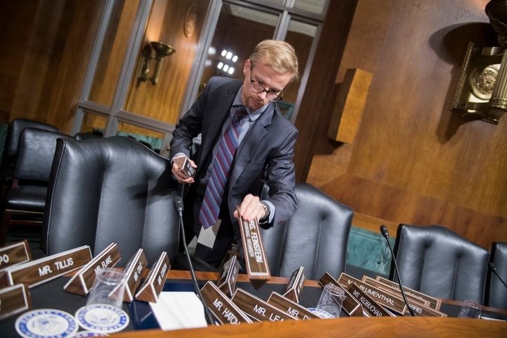 A Senate staffer arranges nameplates in the Senate Judiciary Committee hearing room on Sept. 26, 2018.