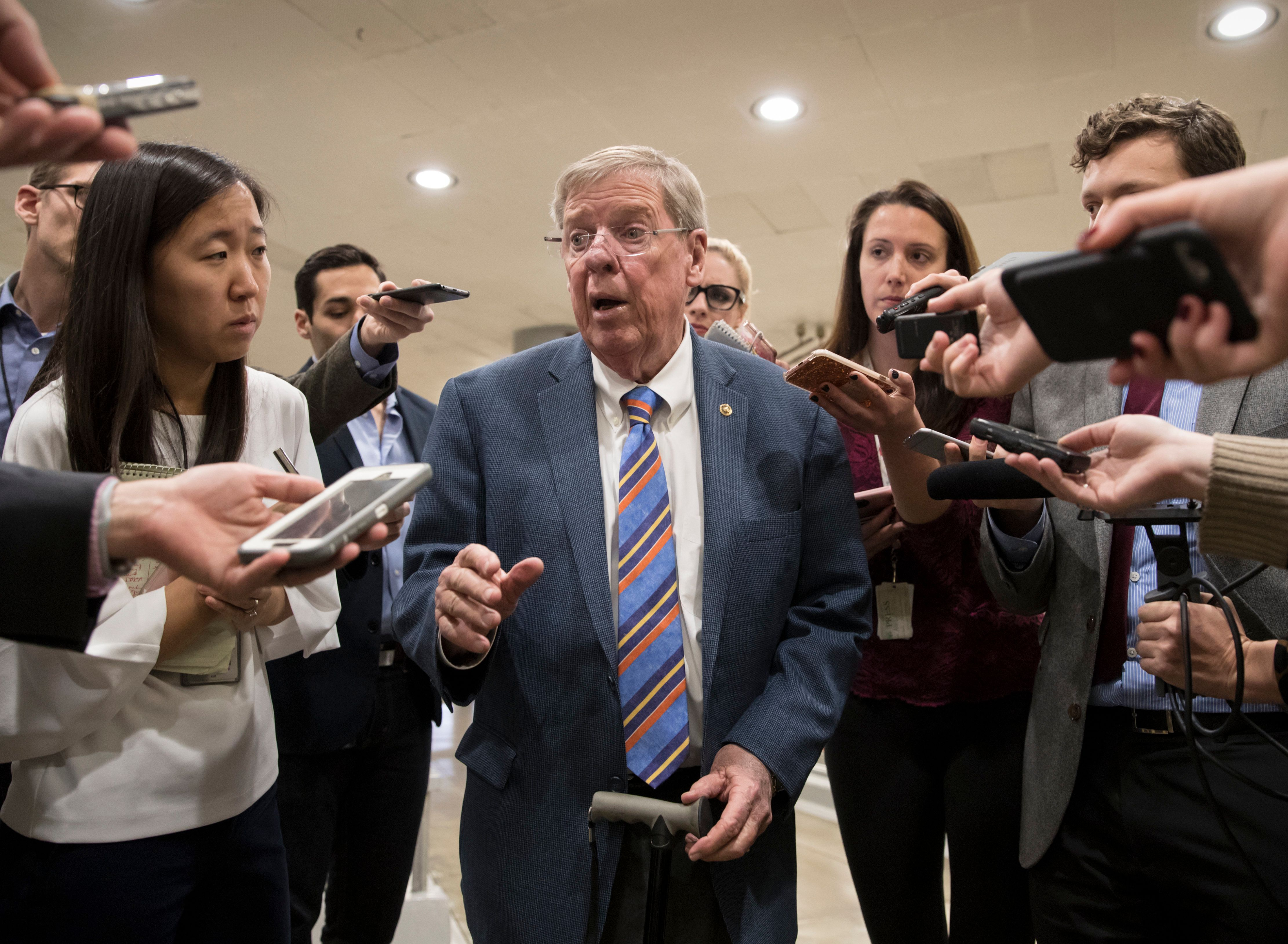 Sen. Johnny Isakson, R-Ga., a member of the tax-writing Senate Finance Committee, takes questions from reporters as he and other lawmakers head to the Senate floor for votes on Capitol Hill in Washington, Monday evening, Nov. 27, 2017. President Donald Trump and Senate Republicans are scrambling to change a Republican tax bill in an effort to win over holdout GOP senators and pass a tax package by the end of the year. (AP Photo/J. Scott Applewhite)