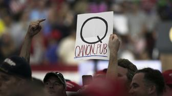 An attendee holds a sign referencing 'QAnon' before the start of a rally with U.S. President Donald Trump in Lewis Center, Ohio, U.S., on Saturday, Aug. 4, 2018. Trump defended his use of tariffs that have inflamed tensions with China and Europe, telling an audience of diehard supporters on Saturday that playing hardball on trade is 'my thing.' Photographer: Maddie McGarvey/Bloomberg via Getty Images
