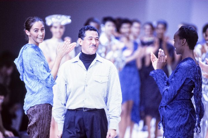 Issey Miyake with models at his spring 1992 runway presentation in France.