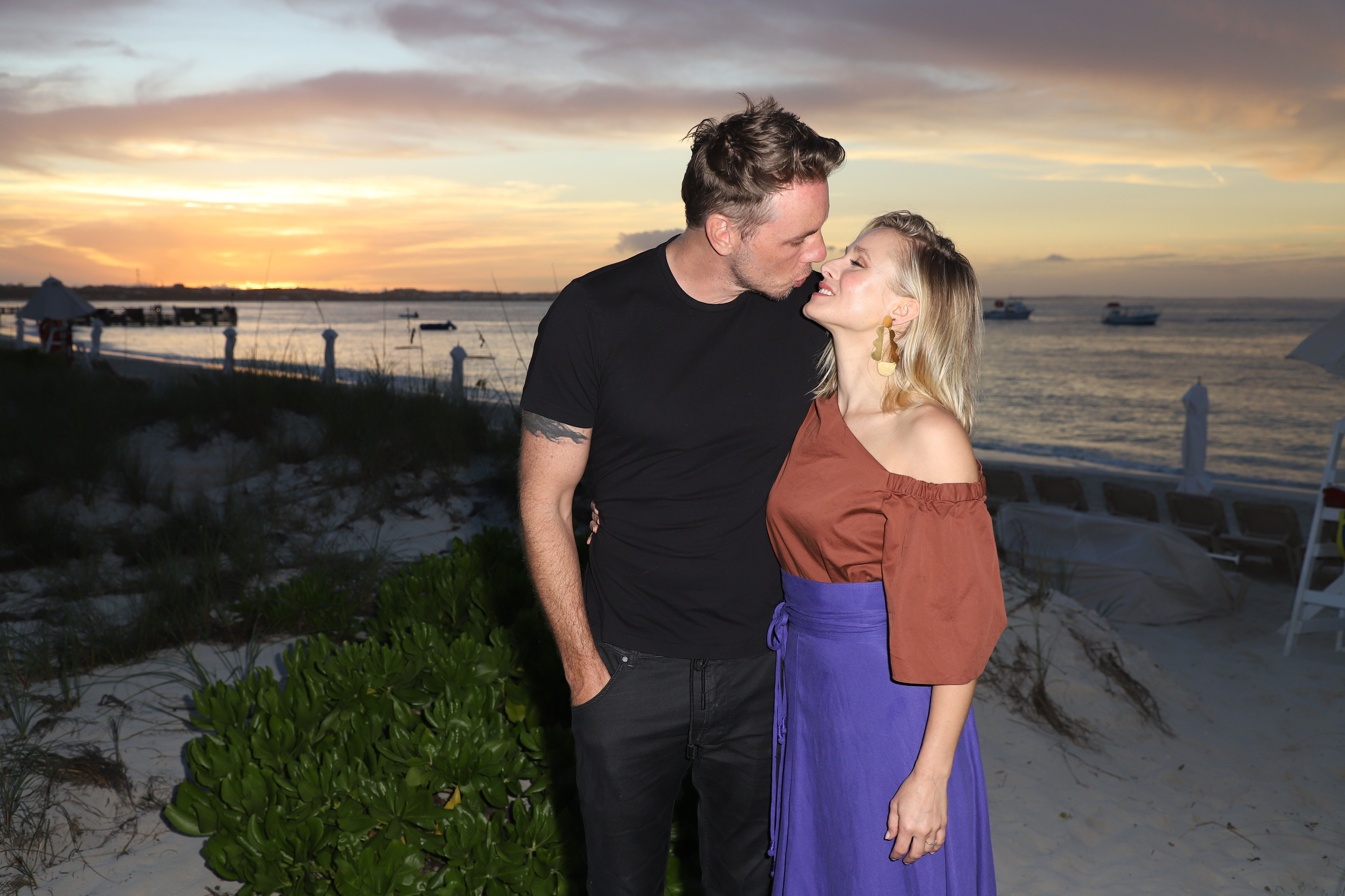 Dax Shepard and Kristen Bell pose on a family vacation at Beaches Turks & Caicos Resort Villages & Spa in 2018.