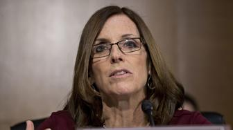 Senator Martha McSally, a Republican from Arizona, questions Jerome Powell, chairman of the U.S. Federal Reserve, not pictured, during a Senate Banking Committee hearing in Washington, D.C., U.S., on Tuesday. Feb. 26, 2019. Powell said a healthy U.S. economy has faced some 'crosscurrents and conflicting signals' that officials in January decided warranted taking a patient approach to future interest-rate changes. Photographer: Andrew Harrer/Bloomberg via Getty Images