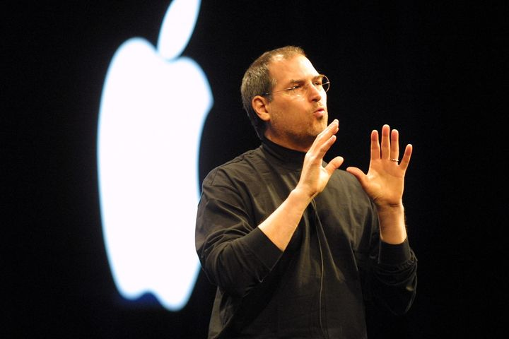 Steve Jobs wears an Issey Miyake black mock turtleneck at Apple's 2001 keynote address in San Francisco.