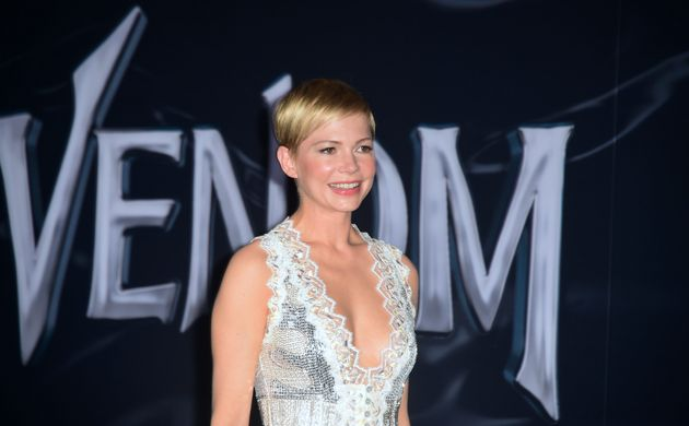 Actress Michelle Williams arrives for the premiere of 'Venom' at the Regency Village theatre in Westwood,...