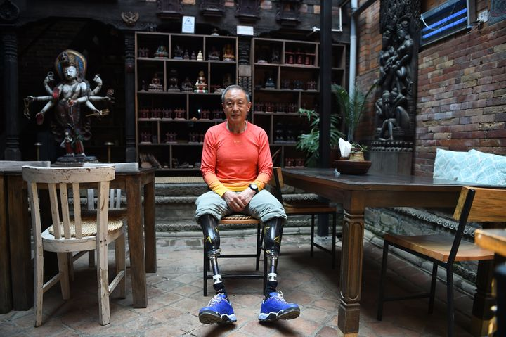 (FILES) In this file photo taken on April 04, 2018 Chinese double amputee climber Xia Boyu, who lost both of his legs during first attempt to climb Everest, pose during an interview with AFP at Bhaktapur on the outskirts of Kathmandu, ahead of another attempt to climb the mountain. A Chinese climber who lost both legs to frostbite on Everest four decades ago reached its top on May 14 morning, becoming one of hundreds of climbers expected to summit the world's highest mountain in coming weeks. / AFP PHOTO / PRAKASH MATHEMA