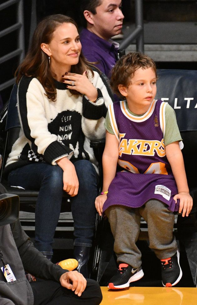 LOS ANGELES, CA - OCTOBER 22: Natalie Portman and her son Aleph Portman-Millepied attend a basketball...