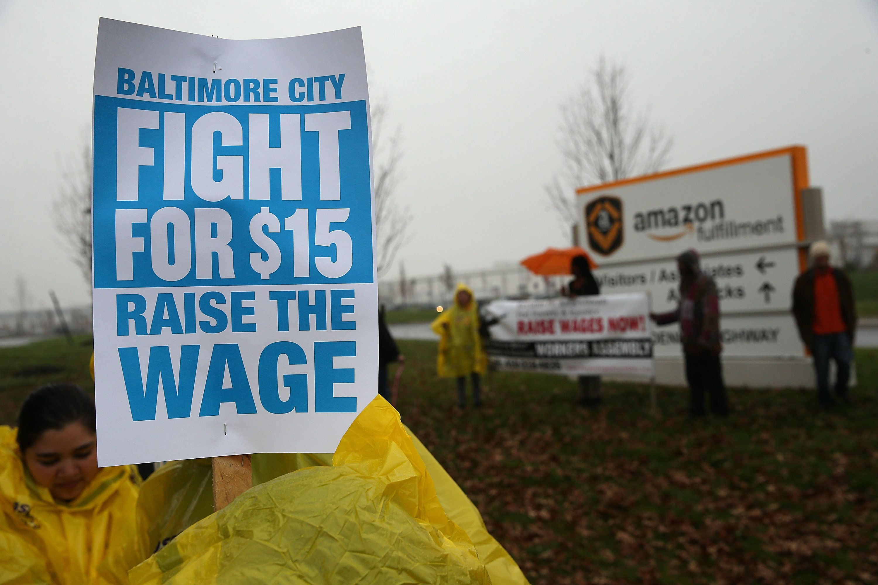 BALTIMORE, MD - NOVEMBER 10:  Protesters rally at a 'Fight for $15 Day of Action' protest outside of an Amazon fulfillment center on November 10, 2015 in Baltimore, Maryland. Local unions assert that 'most of the jobs are temporary, offering no benefits or guarantee of full time employment.'  (Photo by Win McNamee/Getty Images)