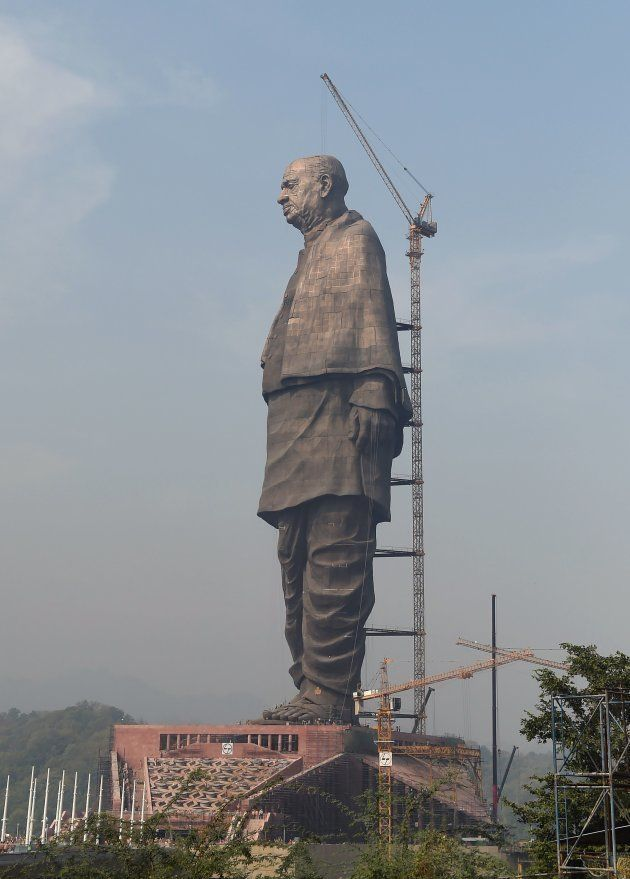 Indian workers give the finishing touches to the world's tallest statue dedicated to Indian independence...