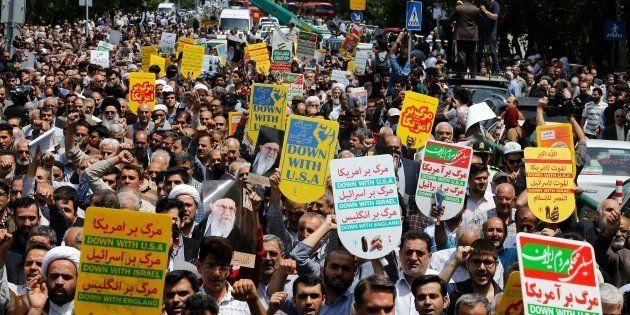 Des Iraniens durant des manifestations anti-américaines à Téhéran le 11 mai