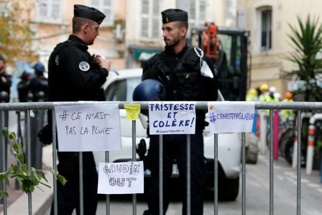 French police secure a street near the rubble of two dilapidated buildings that collapsed this week in...