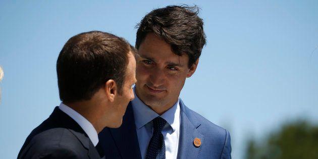 Emmanuel Macron et Justin Trudeau (ici à Charlevoix, au Québec, le 8 juin) ont signé la tribune publiée...
