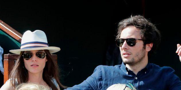 Vianney et sa compagne la violoncelliste Catherine Robert lors du huitième de finale opposant Novak Djokovic...
