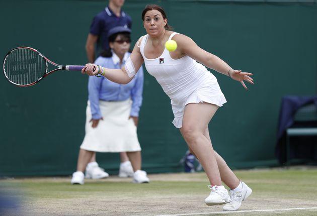 Marion Bartoli en double sur le gazon de Wimbledon, le 14 juillet