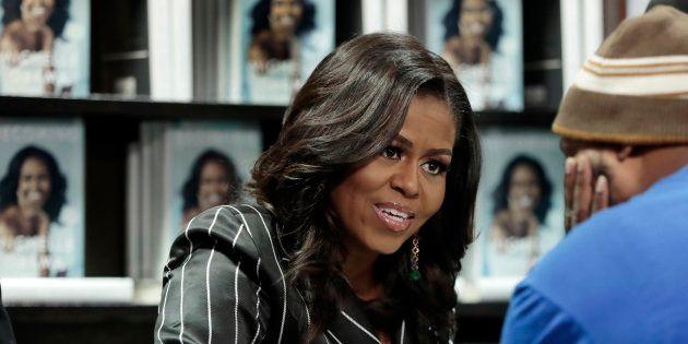Michelle Obama annule sa visite à Paris pour assister aux obsèques de George Bush (Photo