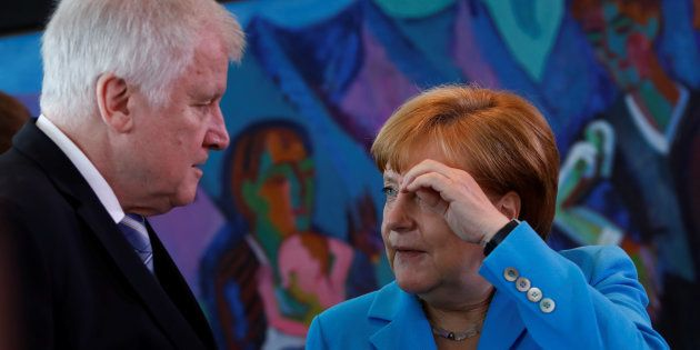 Horst Seehofer, ministre allemand de l'Intérieur et Angela Merkel, le 13 juin