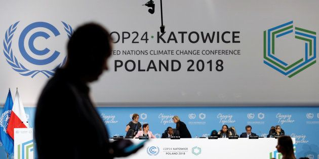 A participant's shilouette is seen during the COP24 UN Climate Change Conference 2018 in Katowice, Poland...