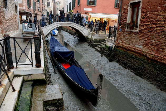 A gondola is seen tied up in Venice, near the Rialto bridge, on January 31, 2018, as exceptionally low...