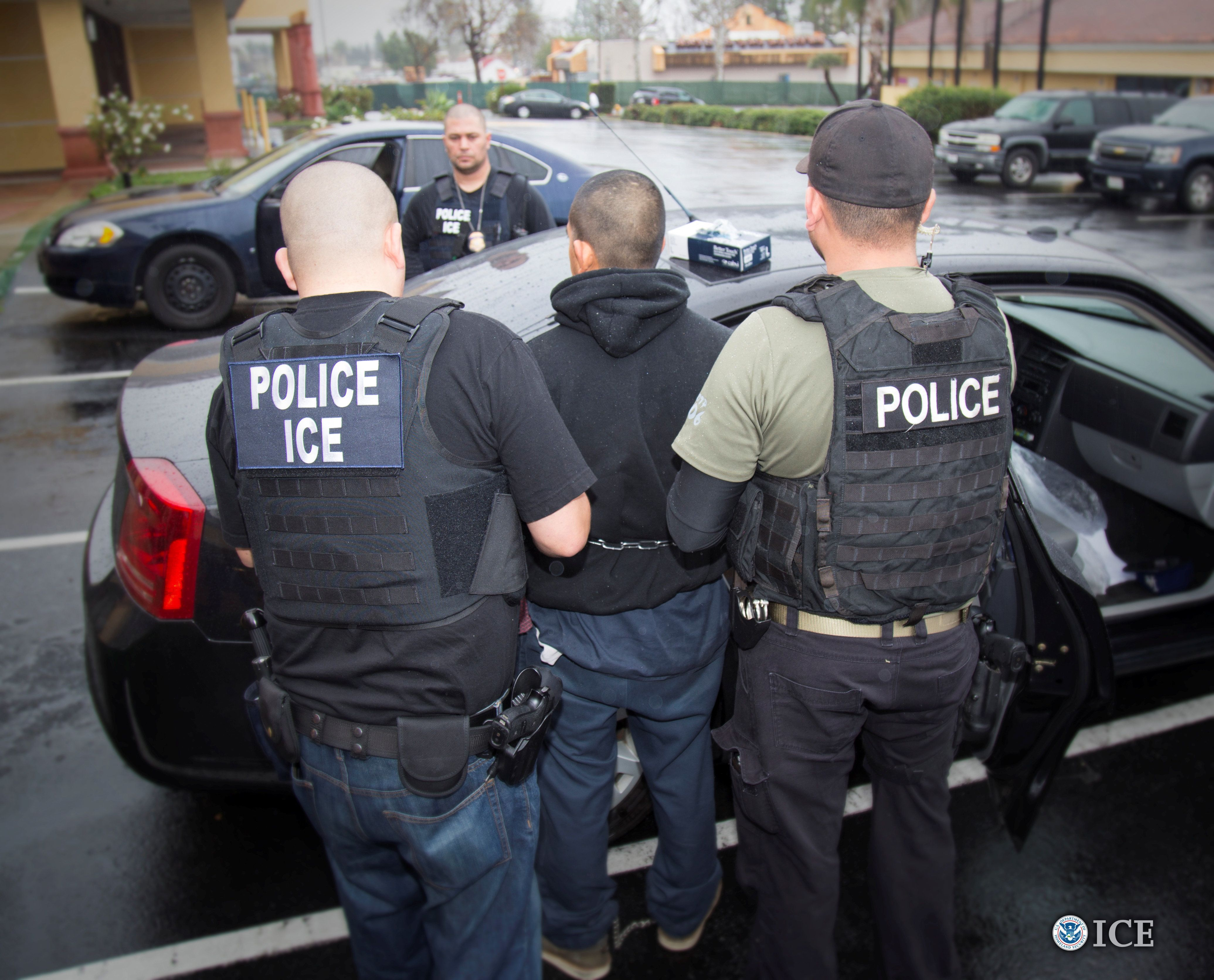 U.S. Immigration and Customs Enforcement (ICE) officers detain a suspect as they conduct a targeted enforcement operation in Los Angeles, California, U.S. on February 7, 2017. Picture taken on February 7, 2017.   Courtesy Charles Reed/U.S. Immigration and Customs Enforcement via REUTERS      ATTENTION EDITORS - THIS IMAGE WAS PROVIDED BY A THIRD PARTY. EDITORIAL USE ONLY.