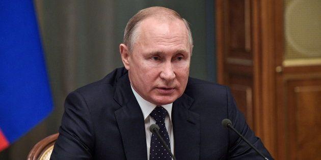 Vladimir Poutine lors d'une réunion avec les membres du gouvernement russe à Moscou le 26 décembre