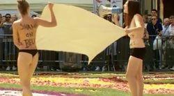 Deux militantes, imitant les Femen, prennent d'assaut le tapis de fleurs à Bruxelles contre l'enfermement