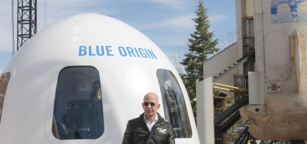 Jeff Bezos, chief executive officer of Amazon.com Inc. and founder of Blue Origin LLC, speaks at the...