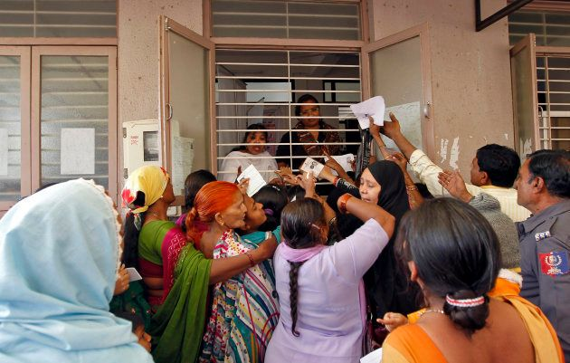 Woman jostle to enrol themselves for Unique Identification (UID) database system in the outskirts of...