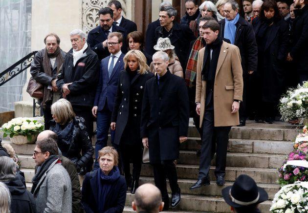 La première dame Brigitte Macron et le ministre de la culture Franck Riester à la sortie des funérailles...