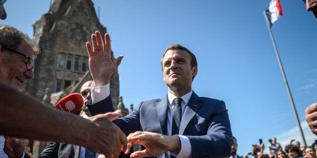 Le Président Emmanuel Macron quitte le bureau de vote du Touquet après avoir voté pour les législatives,...