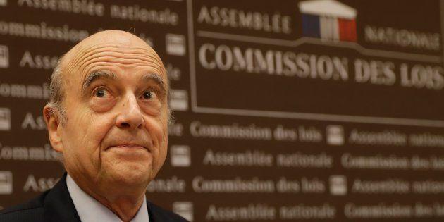 Alain Juppé lors de son audition devant la commission des Lois de l'Assemblée nationale, préalable à...