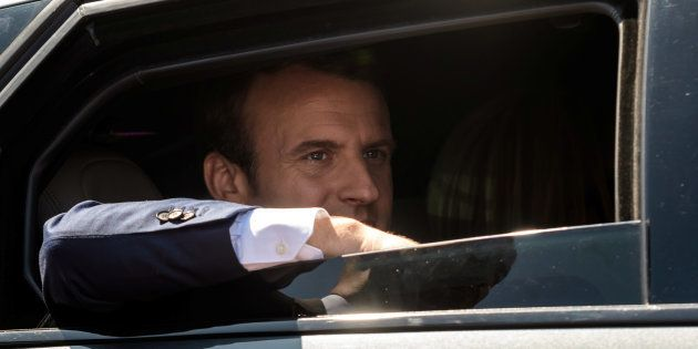 French President Emmanuel Macron leaves the polling station after voting in the first of two rounds of...