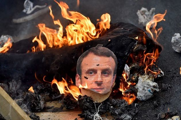 This photo taken on April 7, 2018 shows a burning effigy of French president Emmanuel Macron during a...