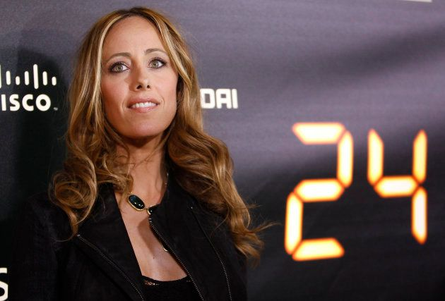 Cast member Kim Raver poses at the party for the television series finale of